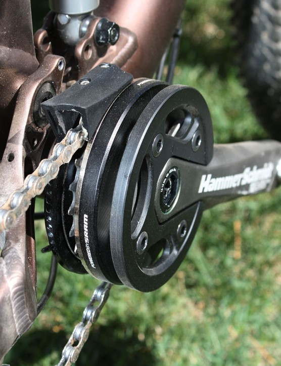 The chainring is fully sandwiched on both sides and with the upper box guide properly positioned, it's virtually impossible to drop a chain.