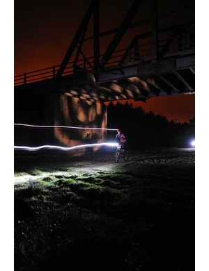 A rider passes under the Bridge to Nowhere