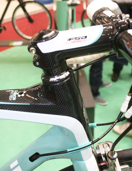 The carbon FSA stem and bars are colour-matched to the frame