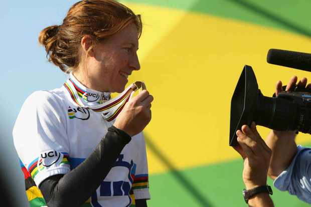 Amber Neben of the USA stands on the podium after winning the Elite Women's Time Trial during the 2008 UCI Road World Championships on September 24, 2008 in Varese, Italy.