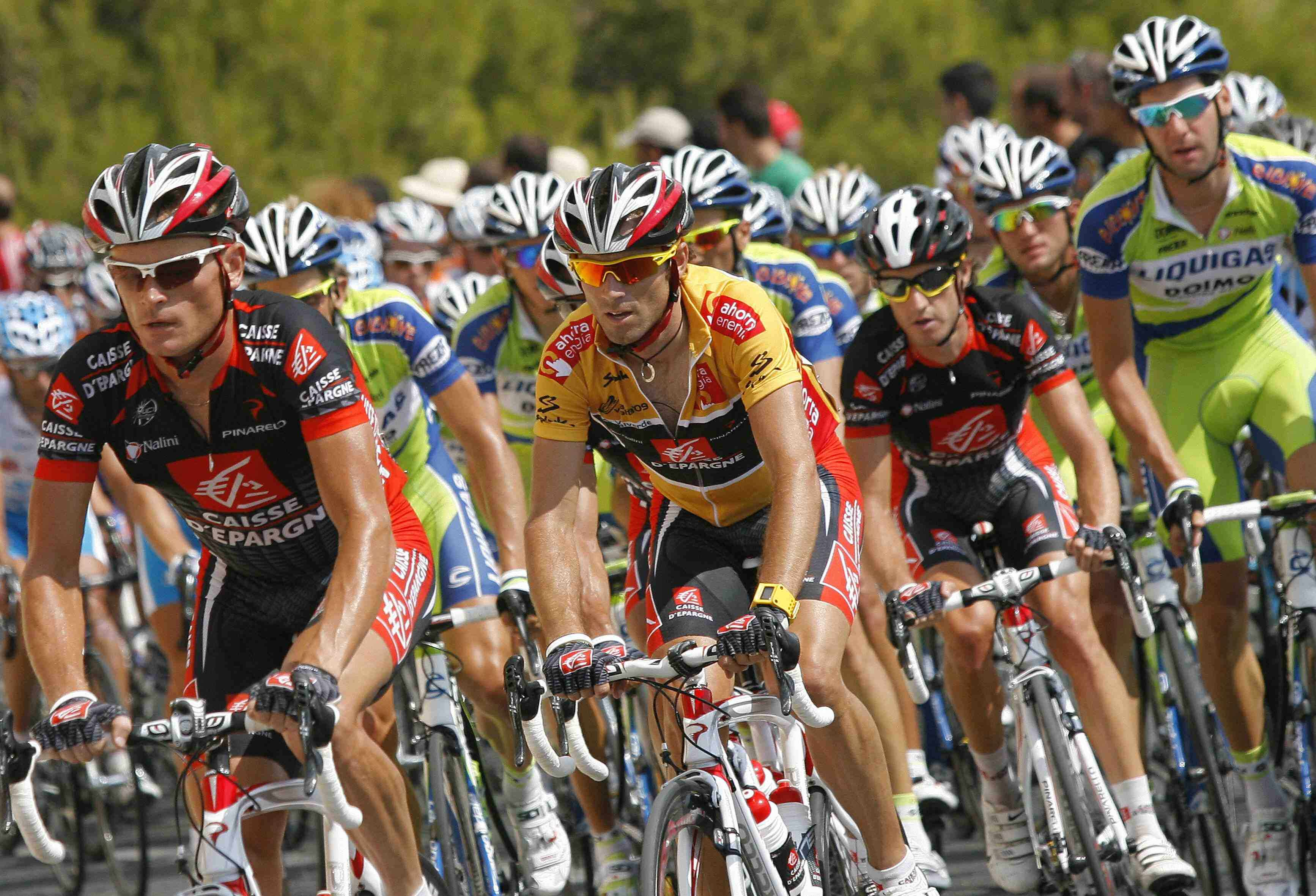 Tour of Spain overall leader Alejandro Valverde (C) has his work cut out for him the next three stages.