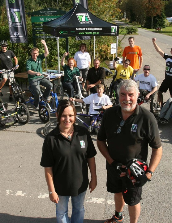 Pictured at the Ae All Abilities Day are Mandy Burgess and Colin Williamson of Forestry Commission Scotland with people attending on the day.