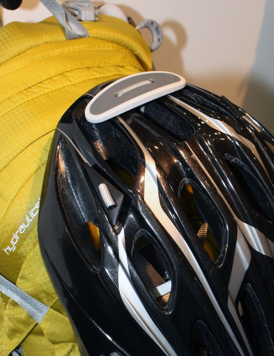 An ingenious helmet holder secures your lid tightly while adding almost no weight or bulk to the pack.