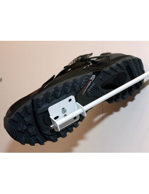 The fully lugged outsole provides superior traction while the partial-length plate hidden beneath still affords efficient pedaling.