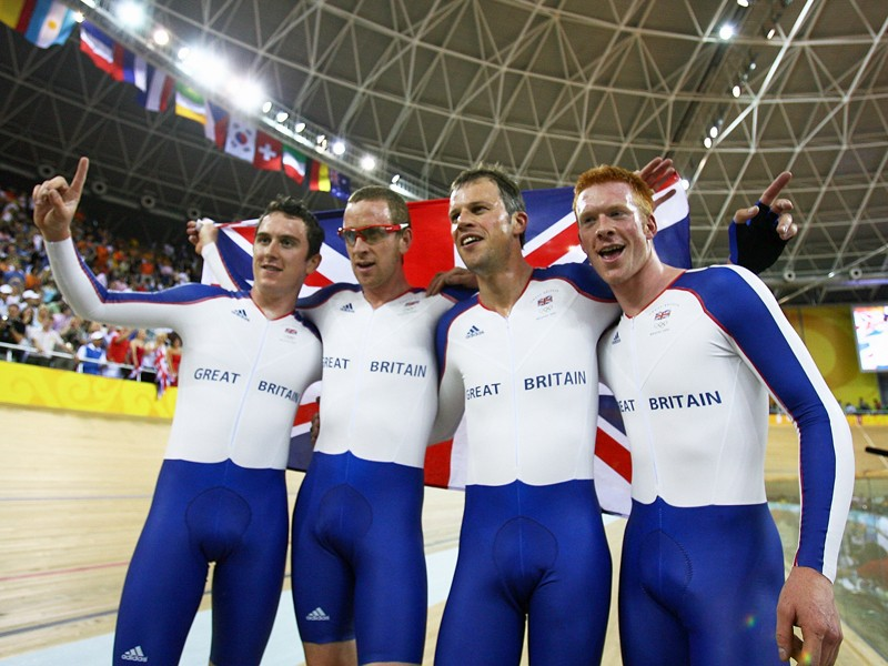 Geraint Thomas celebrates with Paul Manning, Ed Clancy and Bradley Wiggins after winning the gold medal in the men's team pursuit at the Beijing Olympics