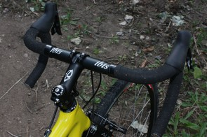 Laser-etched logos on the house-brand bar, stem (and seatpost) make for a complete visual package.