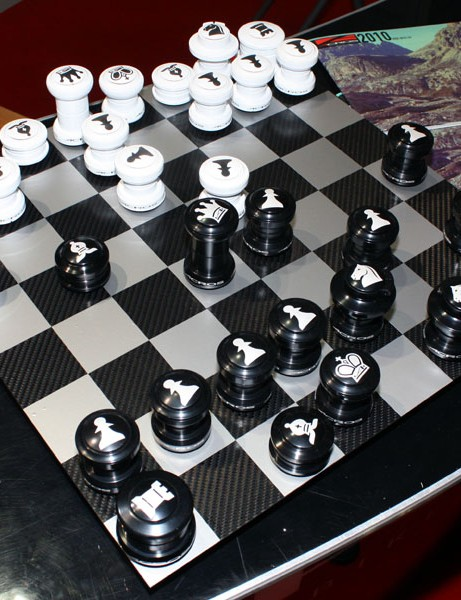 Chess anyone? This is likely one of the most expensive sets available given that the pieces are specially etched Acros headsets and the board is a sheet of carbon fibre.