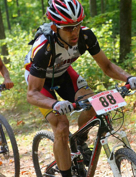 The 2009 Fat 40 Men's champion Brian Matter, climbing Fire Tower Hill.