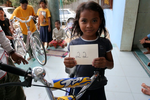 A very happy bike receipient from 88bikes Foundation in The Palm Tree Orphanage, Phnom Penh, Cambodia