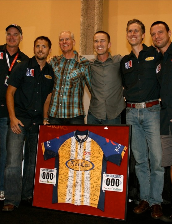 League founder Matt Fritzinger (3rd from left) presented Specialized founder Mike Sinyard (C) with an autographed NorCal League jersey at Interbike on September 23, 2009.