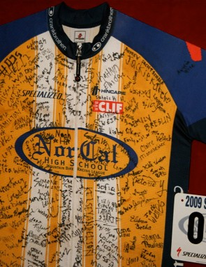 A framed NorCal Racing jersey signed by 100 California high school mountain bike racers.