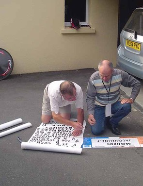Bobby puts the finishing touches to a placard
