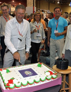Sidi celebrates its 50th anniversary at Interbike with a giant cake and a bit of champagne.
