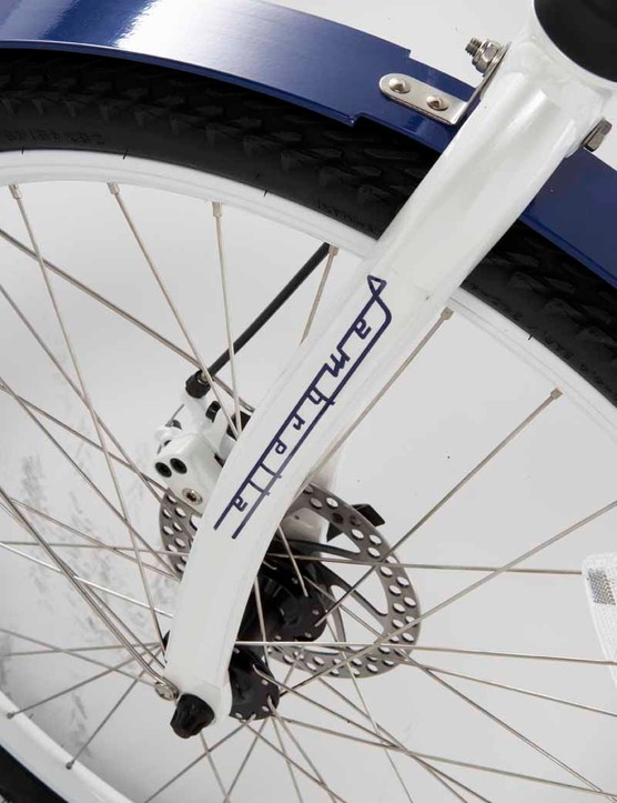 The front fork features an air shock and disc brakes