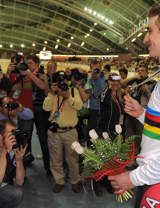 Taylor Phinney (R) poses with his gold medal after the podium ceremony of the men's individual pursuit final during the UCI Track World Championships 2009 on March 26, 2009 at the BGZ Arena in Pruszkow.