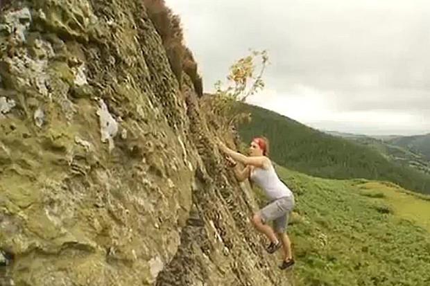 Rachel halfway up a rock
