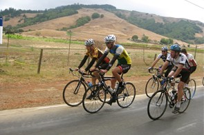 Former national champion Calvin Trampleasure (L) and Otis Guy ride ahead of journalist Bruce Hildenbrand.
