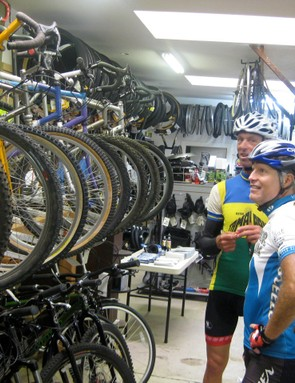 Otis Guy and Joe Breeze admire some of their early handiwork in the racks at Black Mountain Cycles.