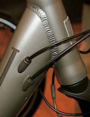 Internal cable routing maintains clean lines and protects housing from the elements.