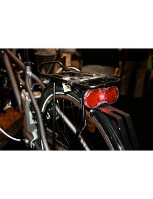 Tail lights surge when braking.