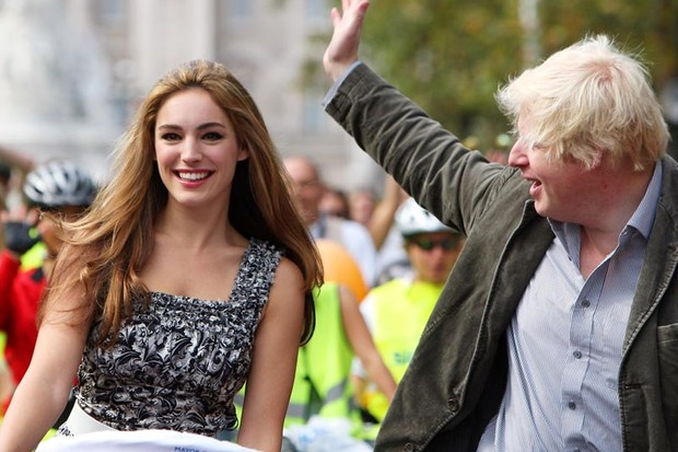 This is definitely not a scene from a first date - it's Kelly Brooke and Boris Johnson enjoying a ride on the recent London Sky Ride