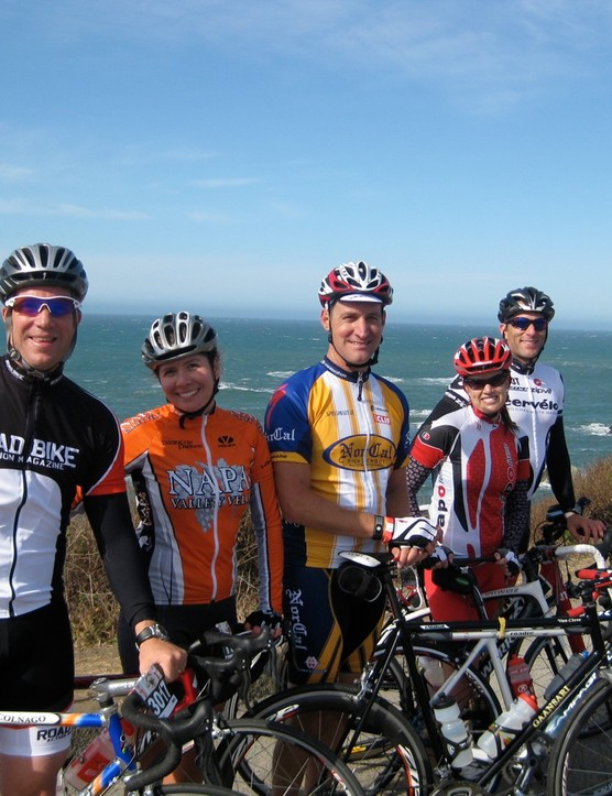 The bike industry crew stopped and smelled the fresh sea air at the halfway point. The author is wearing the yellow and white jersey