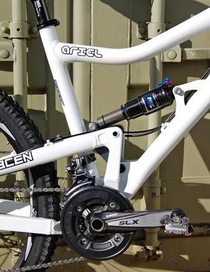 Linkage activated single pivot suspension design