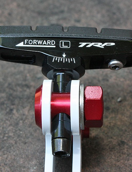 TRP's Inplace Adjust pads allow for easy toe-in adjustments (in a brake design that normally doesn't allow for it) via a clever slotted socket arrangement.  The range isn't as great as the markings would suggest but it's enough to get the job done