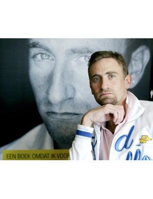 Belgian cyclist Frank Vandenbroucke poses beside a poster of his book 'Ik Ben God Niet' (I'm not god) on April 18, 2008 during a press conference prior to the release of the book.