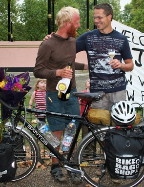 Drinking champagne with Robbert Rutgrink, MD of Santos, who supplied him with his bike