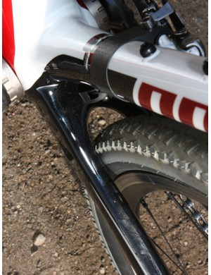 Similarly, there is a lot of room for mud to pass ahead of the rear tire but the lateral clearance is rather tight