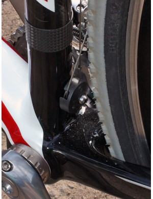 The front derailleur pulley rotates on a bushing, not a bearing, though it's continued to work fine in dry conditions