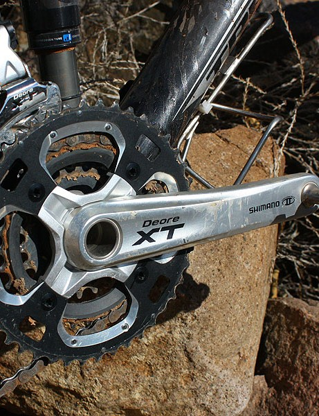 The Deore XT crank features a carbon-reinforced middle ring with steel teeth