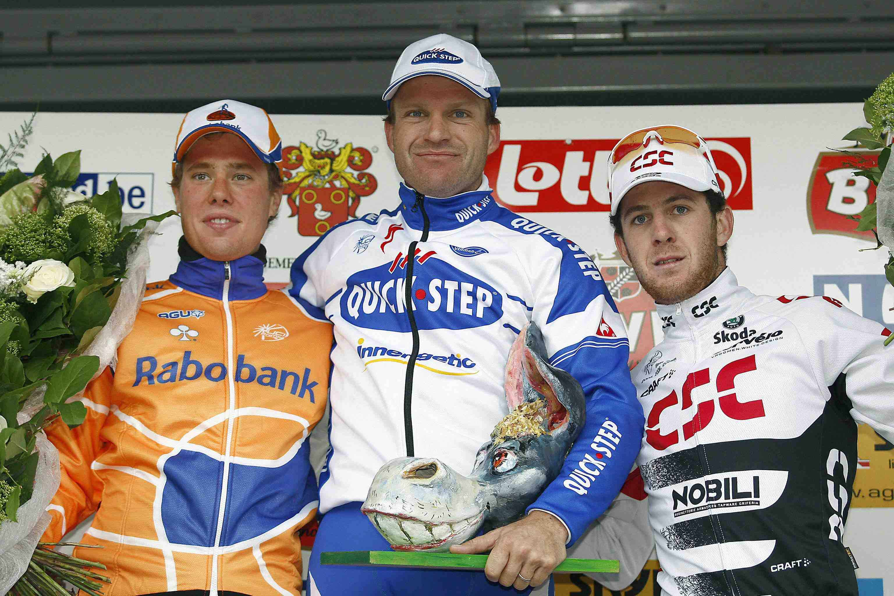 The Netherland's Sebastian Langeveld (L), Steven De Jongh (C) and Australian Matthew Goss (R) pose on the podium after the Kuurne-Brussels-Kuurne cycling race on March 2, 2008.
