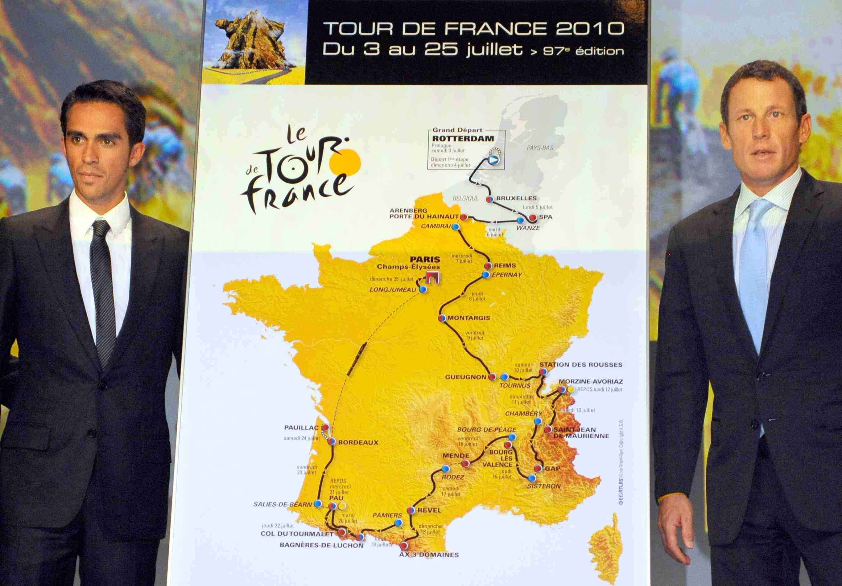 Former Astana teammates Alberto Contador and Lance Armstrong appear at the 2010 Tour de France route announcement in Paris on October 14, 2009.