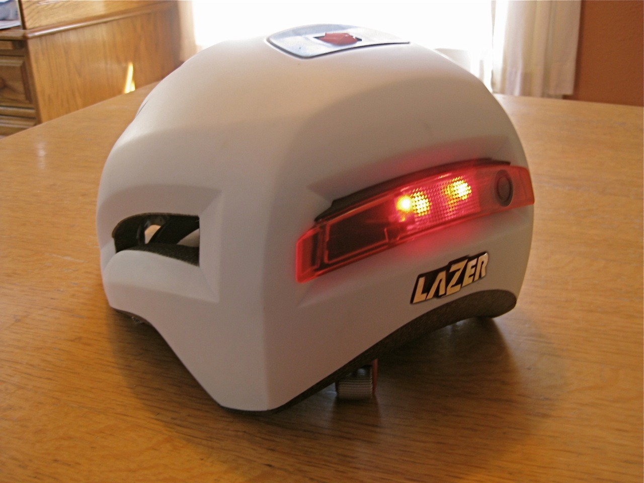 Lazer's patented Rollsys top-mount adjuster makes fit a snap, and the light switches are easy to use. And it bears an uncanny resemblence to a Sinclair C5