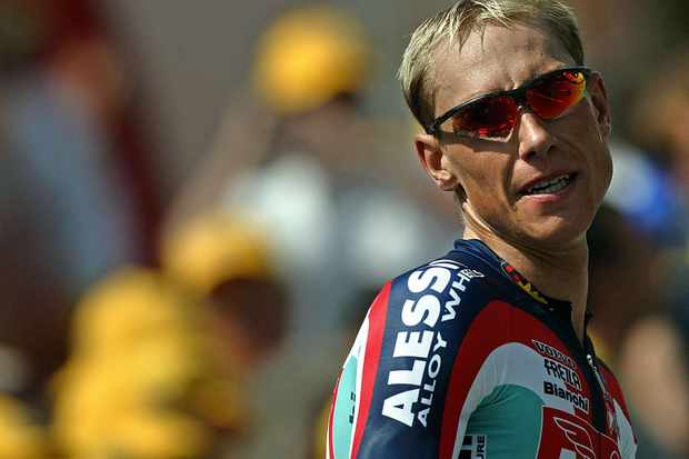 A file photo of Swede Marcus Ljungqvist taken after he crossed the finish line of the 16th stage of the 2004 Tour de France, a time trial between Bourg d'Oisans and L'Alpe d'Huez.