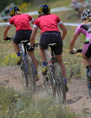 Competitors race in the Women's Short Track Cross Country at the US Mountain Bike National Championships at the Sol Vista Bike Park on July 19, 2009 in Granby, Colorado.