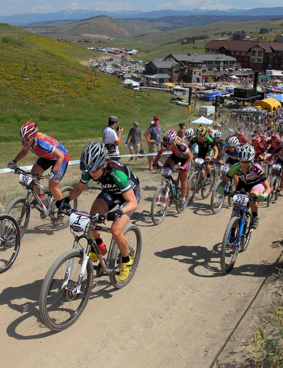 The field leaves the start in the Women's Pro Cross Country at the US Mountain Bike National Championships at the Sol Vista Bike Park on July 18, 2009 in Granby, Colorado.