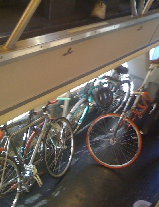 Our new friend Juan stands by his Bianchi Pista in the bike car.