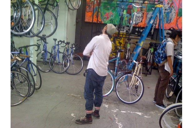 Matty oggles the merchandise at Pedal Revolution in the Mission District.