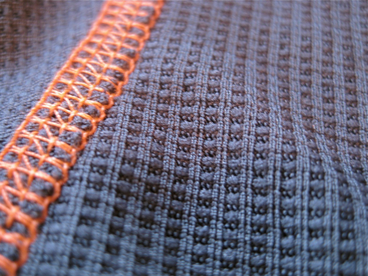 Soft Merino wool on the inside, with synthetic material on the outer shell.