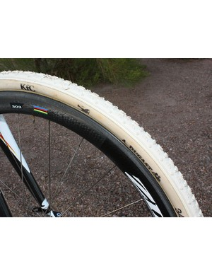The light-and-fast Zipp 303 carbon tubular rims are wrapped in supple Dugast tubulars