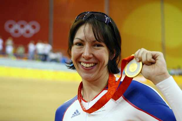 Rebecca Romero of Great Britain poses with her gold medal after winning the women's individual pursuit track cycling final at the Beijing Olympics in August 2008.