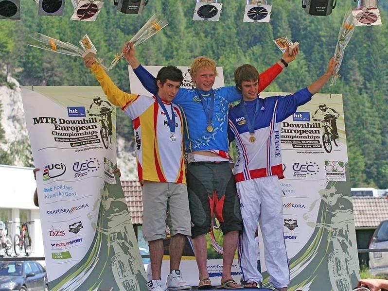 Surrey native Bernard Kerr (C) took gold at the European Downhill Championships in Slovenia.