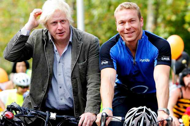 London mayor Boris Johnson (L) rides with Scottish track star Chris Hoy during at The Mayor of London's Skyride on September 20, 2009 in London, England.