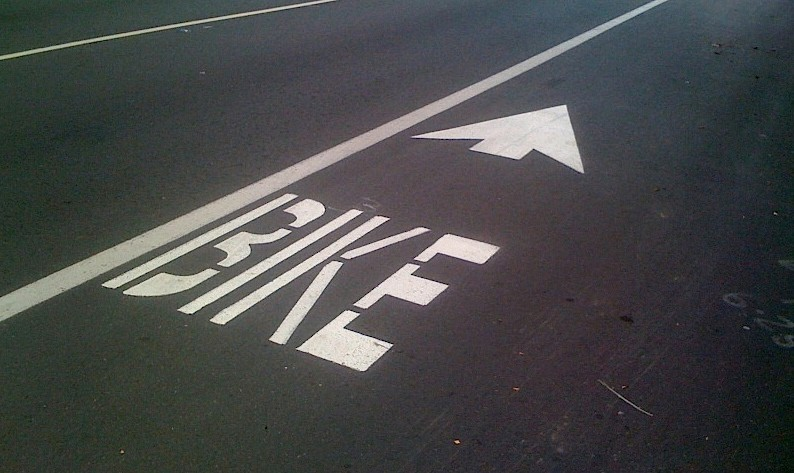 Sharrows are a common sight in California; some use symbols of bikes, others use plain English.