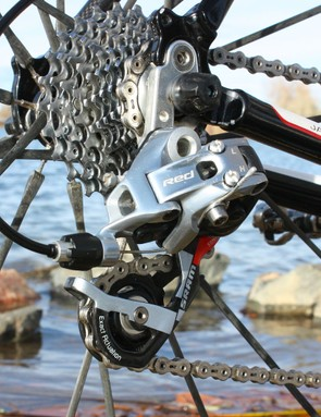 A SRAM Red rear derailleur moves the chain back and forth across the cogs
