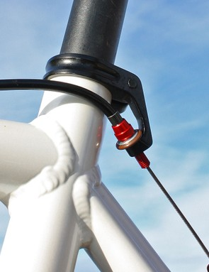 The rear brake cable stop is neatly integrated into the seatpost collar
