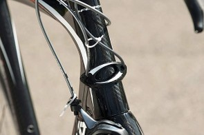 Carbon head-tube badge-cum-cable guide